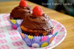 Vanilla Cupcakes with Chocolate Raspberry Frosting via Pale Yellow