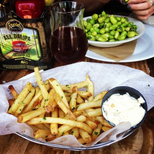 Belgian fries seasoned with herbs and oil, served with charred onion dipping sauce + some fresh garbanzo beans.