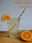 white wine spritzer | pale yellow