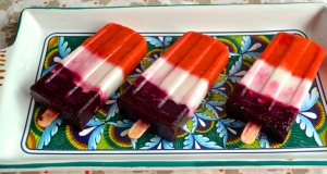 Festive red, white, & blue popsicles | Pale Yellow {layers of strawberry, coconut, and lime}