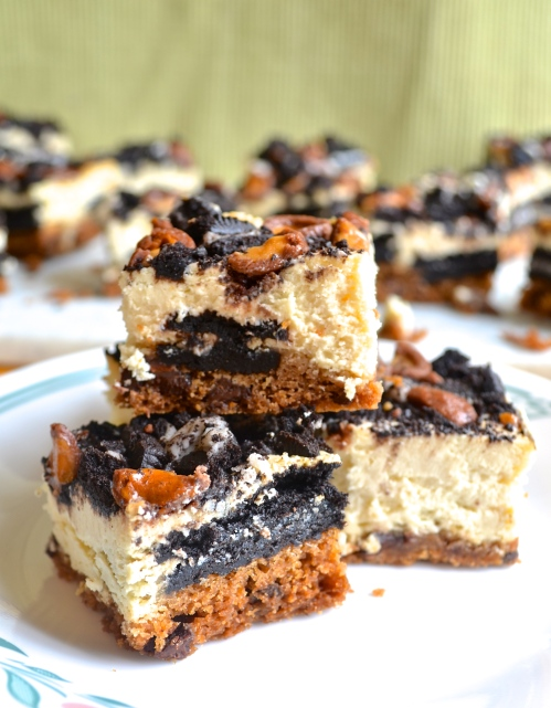slutty cheesecake bars |pale yellow {chocolate chip cookie base, oreos, cheesecake, and whoppers on top}