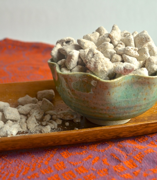 cookie butter puppy chow | pale yellow {chex cereal with chocolate, cookie butter, and lots of powdered sugar!}