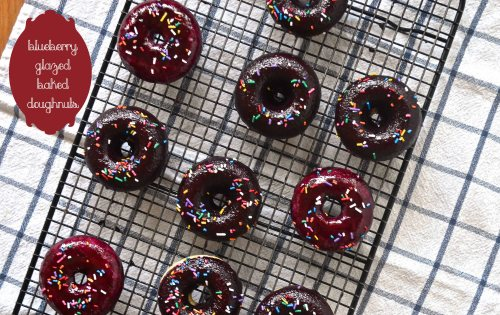 blueberry glazed baked doughnuts | pale yellow